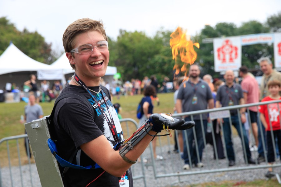 A young guy is showing his innovative invention at Maker Fest in Canada